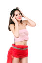 Cheerful young brunette listening to music in headphones isolated on white Stock Photos