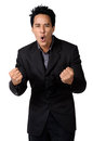 A cheerful young business man with clenched fist isolated businessman in black suit Stock Image