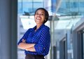 Cheerful young business woman laughing portrait of a outside office building Stock Photography