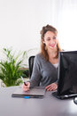 Cheerful young business woman working with computer Stock Photography