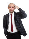 Cheerful young businessman is in pensiveness condition isolated over white Royalty Free Stock Image