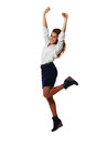 Cheerful young businesswoman jumping with arms up isolated at a white background Royalty Free Stock Photos