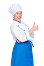 Cheerful young cook showing thumbs up Royalty Free Stock Image