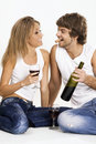 Cheerful young couple drinking wine Stock Photography