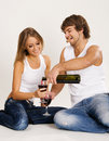 Cheerful young couple drinking wine Royalty Free Stock Photos