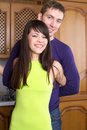 Cheerful young couple at home Royalty Free Stock Photos