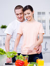 Cheerful young couple in the kitchen Stock Photo
