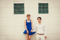 Cheerful young couple standing on white background outdoor Stock Photo