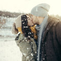 Cheerful young couple walking in a winter day loving on natural background Royalty Free Stock Images