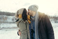 Cheerful young couple walking in a winter day loving on natural background Royalty Free Stock Photo