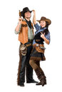 Cheerful young cowboy and cowgirl Stock Photos