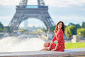 Cheerful young girlin front of the Eiffel tower in Paris, France Royalty Free Stock Photo