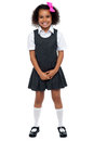 Cheerful young kid in pinafore dress Royalty Free Stock Photography