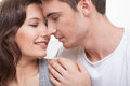 Cheerful young lovers are resting at home i love you cute loving couple is embracing and smiling their eyes closed with joy Stock Photography