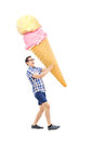 Cheerful young man carrying an enormous ice cream full length portrait of a isolated on white background Stock Image