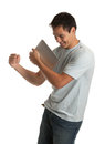 Cheerful young man holding a touch pad tablet pc laughing casual on isolated white background Stock Images