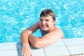 Cheerful young man in pool smiling Royalty Free Stock Images