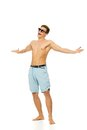 Cheerful young man in shorts on white background Royalty Free Stock Photography