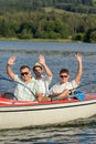 Cheerful young men sitting in motorboat enjoying sunshine Stock Photography