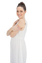 Cheerful young model in white dress posing on background Royalty Free Stock Photos