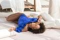 Cheerful young mulatto girl sunbathing on resort Royalty Free Stock Photo