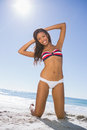 Cheerful young sexy woman taking sun on the beach Stock Photos
