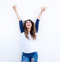 Cheerful young woman with arms raised and looking up Royalty Free Stock Photo