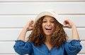 Cheerful young woman with hat laughing outdoors closeup portrait of a Stock Photography