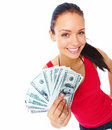 Cheerful young woman holding cash and smiling Royalty Free Stock Photography