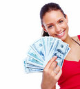 Cheerful young woman holding cash and smiling Royalty Free Stock Images