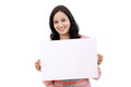Cheerful young woman holding empty white board against Stock Photography