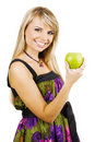 Cheerful young woman holding a fresh freen apple Stock Photos