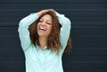 Cheerful young woman laughing with happy expression portrait of a Stock Photography