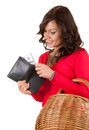 Cheerful young woman looking to wallet with dolars Royalty Free Stock Images