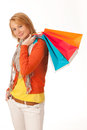 Cheerful young woman with shopping bags isoleted on  white Stock Photos