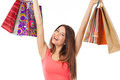 Cheerful young woman with shopping bags pretty brunette holding and looking very happy isolated on white Royalty Free Stock Photography
