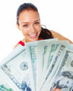 Cheerful young woman showing cash and smiling Royalty Free Stock Images