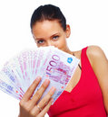 Cheerful young woman showing euro cash and smiling Stock Photography