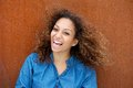 Cheerful young woman smiling with curly hair close up portrait of a Royalty Free Stock Image