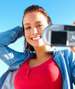 Cheerful young woman taking self portrait Royalty Free Stock Photography