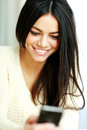 Cheerful young woman using her smartphone closeup portrait of a Royalty Free Stock Images
