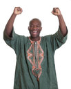 Cheering african man with traditional clothes and arms outstretched