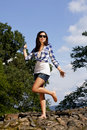 Cheering brunette teenage girl with sunglasses Royalty Free Stock Image