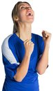Cheering football fan in blue jersey on white background Royalty Free Stock Photo