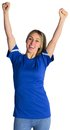 Cheering football fan in blue jersey on white background Stock Photo