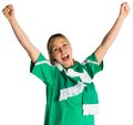 Cheering football fan in green jersey on white background Royalty Free Stock Image