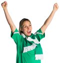 Cheering football fan in green jersey on white background Stock Photo