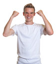 Cheering guy with blond hair young blue eyes and on isolated white background Stock Photography