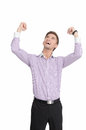 Cheering men happy young men standing with his hands up man against white background Royalty Free Stock Images
