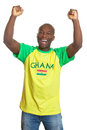 Cheering sports fan from ghana on an isolated white background is happy about his national team Royalty Free Stock Image